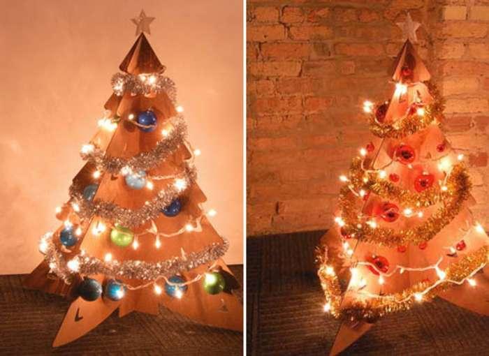 Un rbol de navidad de cart n - Arbol de navidad con luces ...